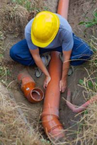 Plumber repairing sewer line with high pressure jet by Relief Home Services
